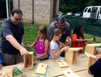 Cross and Crown Lutheran Church Men's Group help build birdhouses at Cos Kids