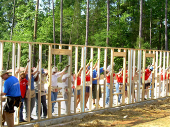 Habitat for Humanity volunteers constructing a wall